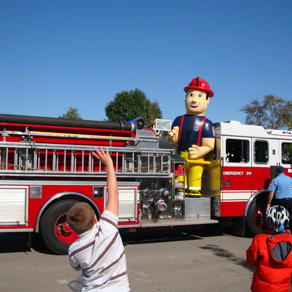 INFLATABLE FIREMAN MASCOT IN PARADE
