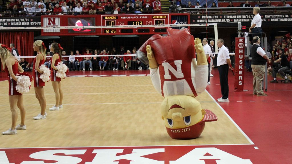INFLATABLE NEBRASKA MASCOT LIL RED DOING HEADSTAND
