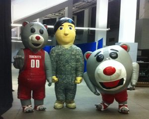 HOUSTON ROCKETS INFLTABLE MASCOTS WITH A MILITARY MASCOT